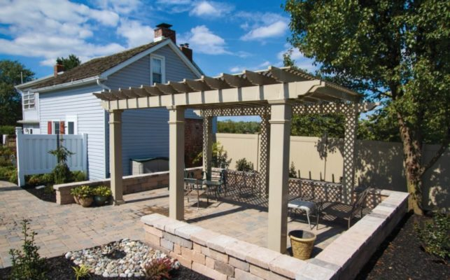 freestanding pergola over a patio in almond color