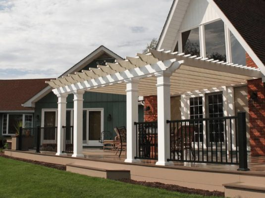 pergola that is attached to a deck and house